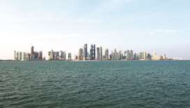 City skyscrapers are seen on the skyline in Doha. The deficit estimate of Qatar is calculated taking