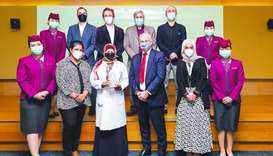 Qatar Airways Group medical director Dr John Roberts and his team with HMC Swab Research Center's Dr