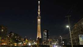 The Tokyo Skytree is illuminated with the colour of the Olympic Torch to mark 100 days until the sta