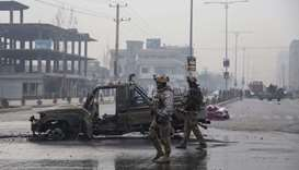 Members of the Afghan security forces stand at the site of an attack, in Kabul