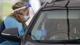A medical worker speaks with a driver at the Bondi Beach drive-through coronavirus disease (COVID-19