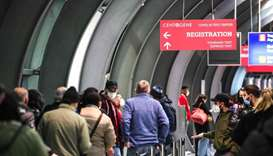 Passengers line up at a Covid-19 test centre at Frankfurt International Airport in Frankfurt am Main
