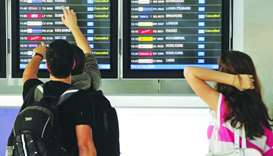 Travelers look at a departure schedule at Suvarnabhumi International Airport in Bangkok (file).