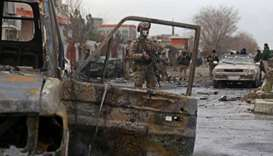 A member of Afghan security force stands guard at the site of an attack in Kabul on December 20