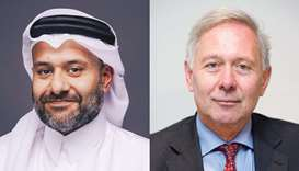 QFC Authority chief executive Yousuf Mohamed al-Jaida and WAIFC chairman Arnaud de Bresson.