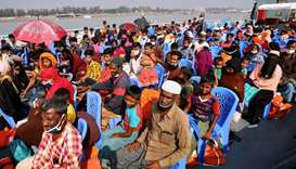 Rohingya refugees are seen aboard a ship as they are moved to Bhasan Char island in Chattogram, Bang