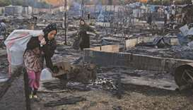 Hundreds of Syrians flee camp in Lebanon after tents torched