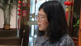 Citizen-journalist Zhang Zhan is seen in Wuhan, Hubei province, China in this handout picture taken
