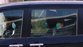 Hong Kong activists detained in mainland China over an illegal border crossing is seen in a vehicle