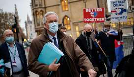 EU chief negotiator Michel Barnier (C), wearing a protective face covering to combat the spread of t