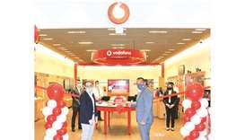 Diego Camberos (right) opening Vodafone's DHFC store.