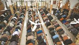 Muslims offer weekly Friday prayers at a mosque in Islamabad yesterday. The government has announced
