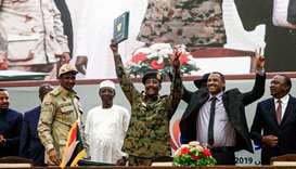 Sudan's protest leader Ahmad Rabie (2nd-R), flashes the victory gesture alongside General Abdel Fatt