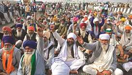 Farmers shout slogans during a protest against the central government's recent agricultural reforms