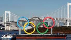 Olympic rings, which were temporarily taken down in August for maintenance, are towed by a boat for