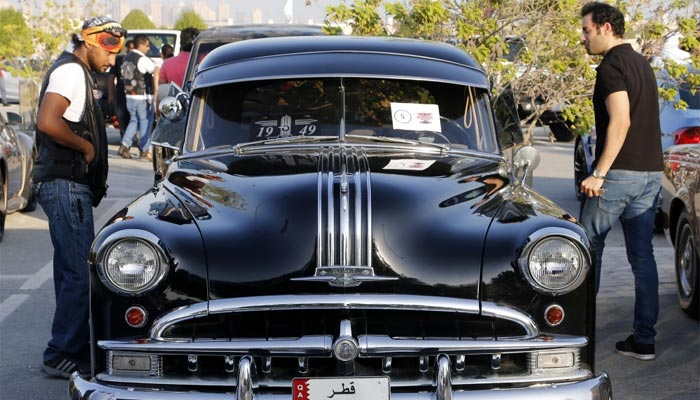 A vintage automobile draws interest from visitors of Mowater Qatar 2015. PICTURE: Jayaram.