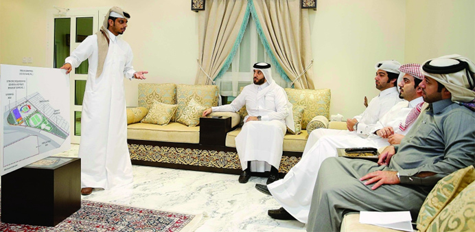 Officials discuss details of the stadium coming up at Al Thumama.