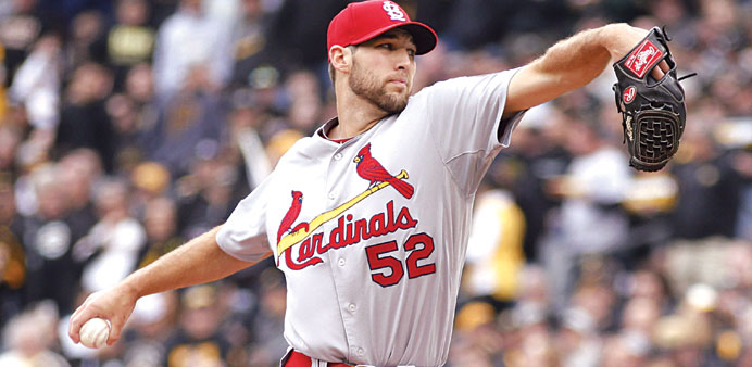 Wacha pitches gem as Cardinals keep season alive