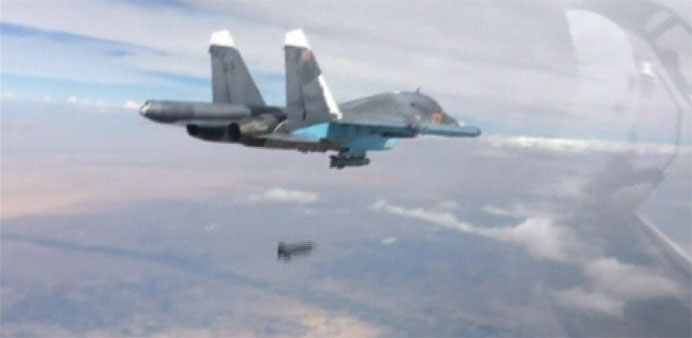 Footage released by Russia's Defence Ministry, shows a Su-34 fighter-bomber dropping a bomb over Syr
