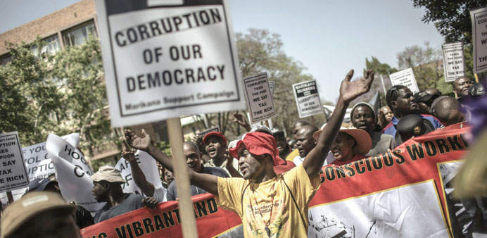 An anti-corruption activist shouts slogans in Pretoria during a demonstration against corruption org