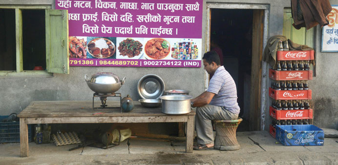 A Nepalese man prepares food on a kerosene stove amid shortage of gas cylinders in Kakarbhitta on th