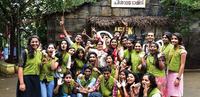 Some of the delegates of the film festival pose in front of one of the venues of the event in Thiruv