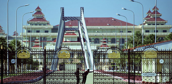 Police personnel open the gates to the Myanmar parliament in Naypyidaw yesterday.