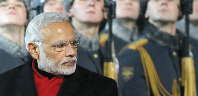 Prime Minister Narendra Modi inspects the honour guard during a welcoming ceremony upon his arrival
