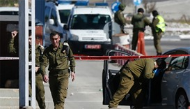 Israeli security forces inspect the place where a Palestinian man who was shot dead