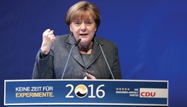 Merkel urges patience on her refugee policy