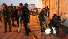 Israeli security forces work at the site of a stabbing attack near the shared religious site known t