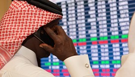 Qatar shares close lower but stay above 10,400