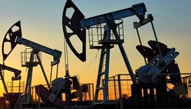 Oil prices fall on stronger dollar; Russia warns of longer glut