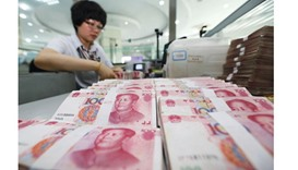 Yuan bears say outflow just starting as Goldman Sachs warns of shocks