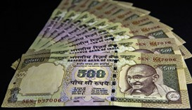 The rupee dropped 0.2% to 67.98 a dollar yesterday