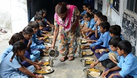 Nearly 100 Indian pupils in hospital after eating school meal