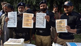 Pakistan police seize millions from fake currency factory