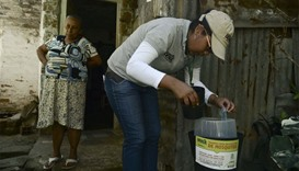 A researcher checks mosquito traps in the Paris neighborhood, Bello municipality, Antioquia departme