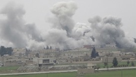 Smoke rises over the northern Syrian town of Tel Abyad