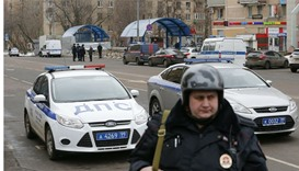 A Russian police officer stands at the site where a woman suspected of murdering a young child was d