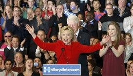 Former US President Bill Clinton (rear) applauds his wife, Democratic US presidential candidate Hill