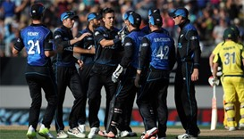 Trent Boult (C) of New Zealand celebrates with teammates