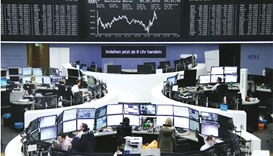 Traders work at the stock exchange in Frankfurt. The DAX closed 1.14% down at 9,286.23 points yester