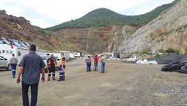 Rescue workers and vehicles stand by at the scene of the mine collapse near Barberton. Seventy-five