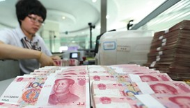 A teller counts yuan banknotes in a bank in Lianyungang, China. The currency has strengthened 0.4% i