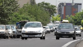 The file photo taken on July 24, 2012 shows Iranians driving locally-manufactured Peugeot 206 cars i