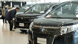 A man looks at Toyota cars at the company's showroom in Tokyo. Japan, North America and Europe conti