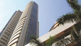 Sensex rises; rupee falls to one-month low