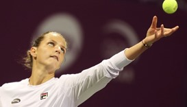 Karolina Pliskova of the Czech Republic serves the ball to Denmark's Caroline Wozniacki