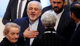 Iranian Foreign Minister Mohammad Javad Zarif gestures next to the former US secretary of state Made